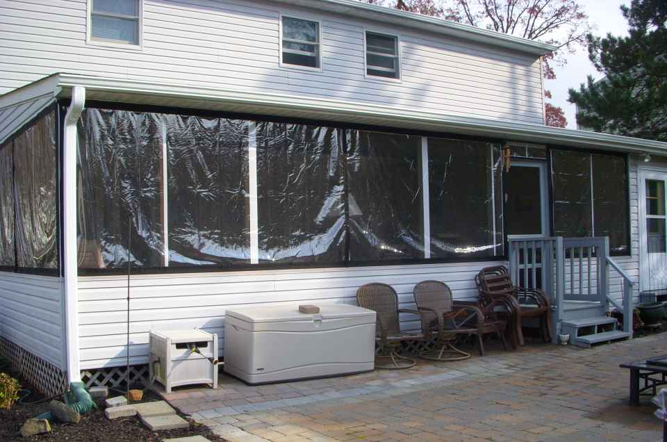 These Winter Drop Panels Were Placed Over An Existing Screened In Porch To  Create This Clear Plastic Enclosure. Plastic Patio Panels