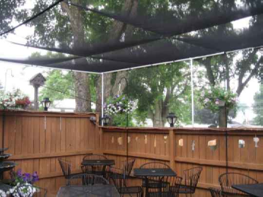 Outdoor Seating At A Restaurant Using Painted Pipe Frame Application And Heavy Mosquito Netting Mesh
